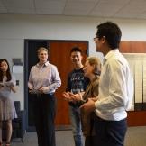 Jan Warren, Susan Assouline and graduate student Jiaju Wu welcome the students and families.
